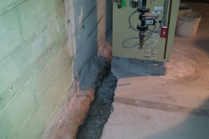 Installation of french drain - exposed footing | Before