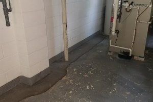 Interior french drain finished behind utilities and furnish | Eco-Dry Waterproofing