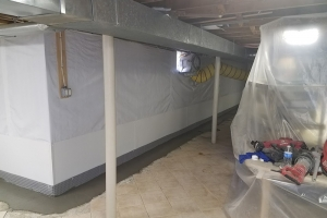 Interior french drain finished w/vapor barrier around tile floor | Eco-Dry Waterproofing